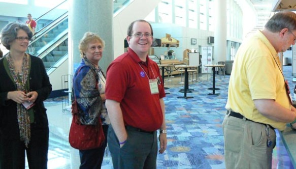 Beau Surratt, a volunteer at the Chicago Consultation booth, queues for lunch at the convention center.