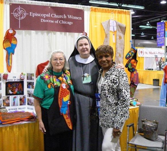 Jane McCarron, Sister Mary Cecelia and Chicago UTO coordinator Glenda Gwynn pose for a picture at the Chicago Episcopal Church Women booth in the exhibit hall.